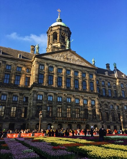 Dam Square in Amsterdam. Traveling to Amsterdam? Read the ultimate guide with insider local tips for what to do in Amsterdam, what to eat in Amsterdam, and where to stay in Amsterdam! #travel #Amsterdam